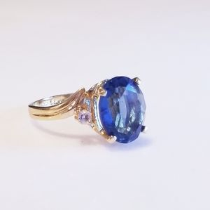 Blue Topaz Ring in Gold Setting With Begets